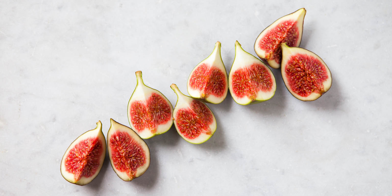 Chopped fresh figs on marble worktop