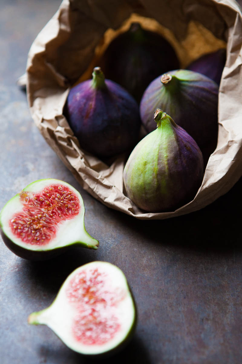 Brown paper bag of fresh figs