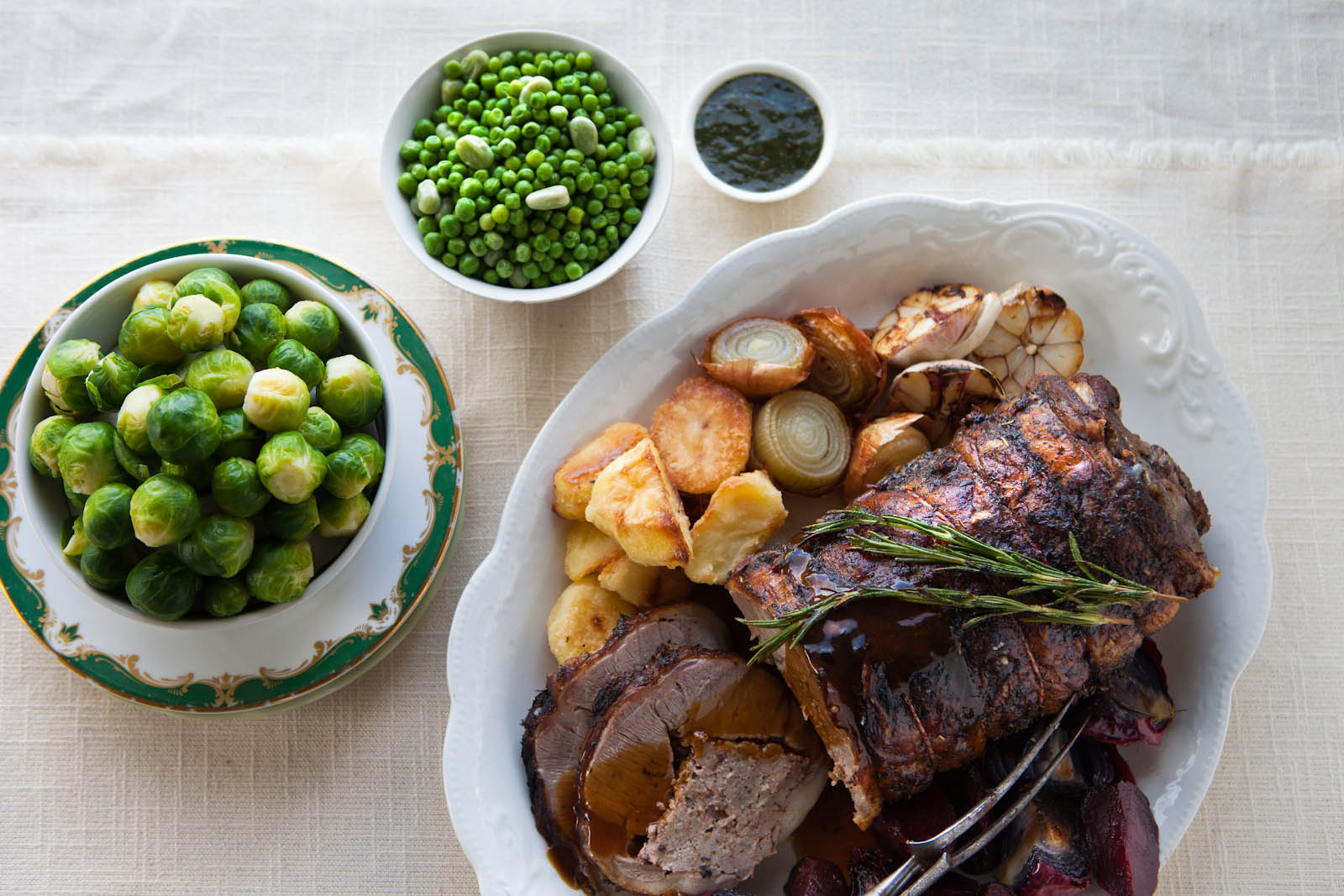 Whole saddle of lamb with mint and rosemary