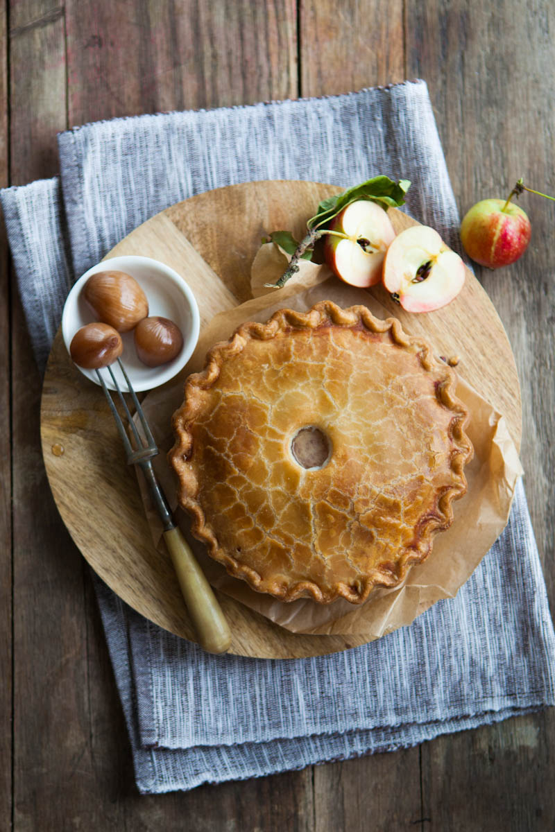 Pioneer retail delicious pork pie served with apple wedges and pickled onions