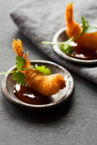 Delicious noodle prawns with sweet chilli sauce and coriander
