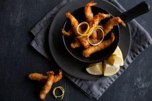 Torpedo shrimp with lemon garnish