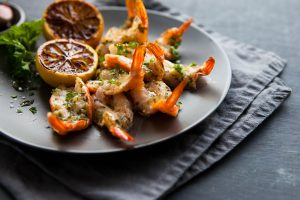Delicious butterfly shrimp with garlic herbs and scor