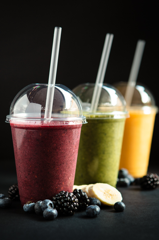 freshly made fruit smoothies with berries and bananas