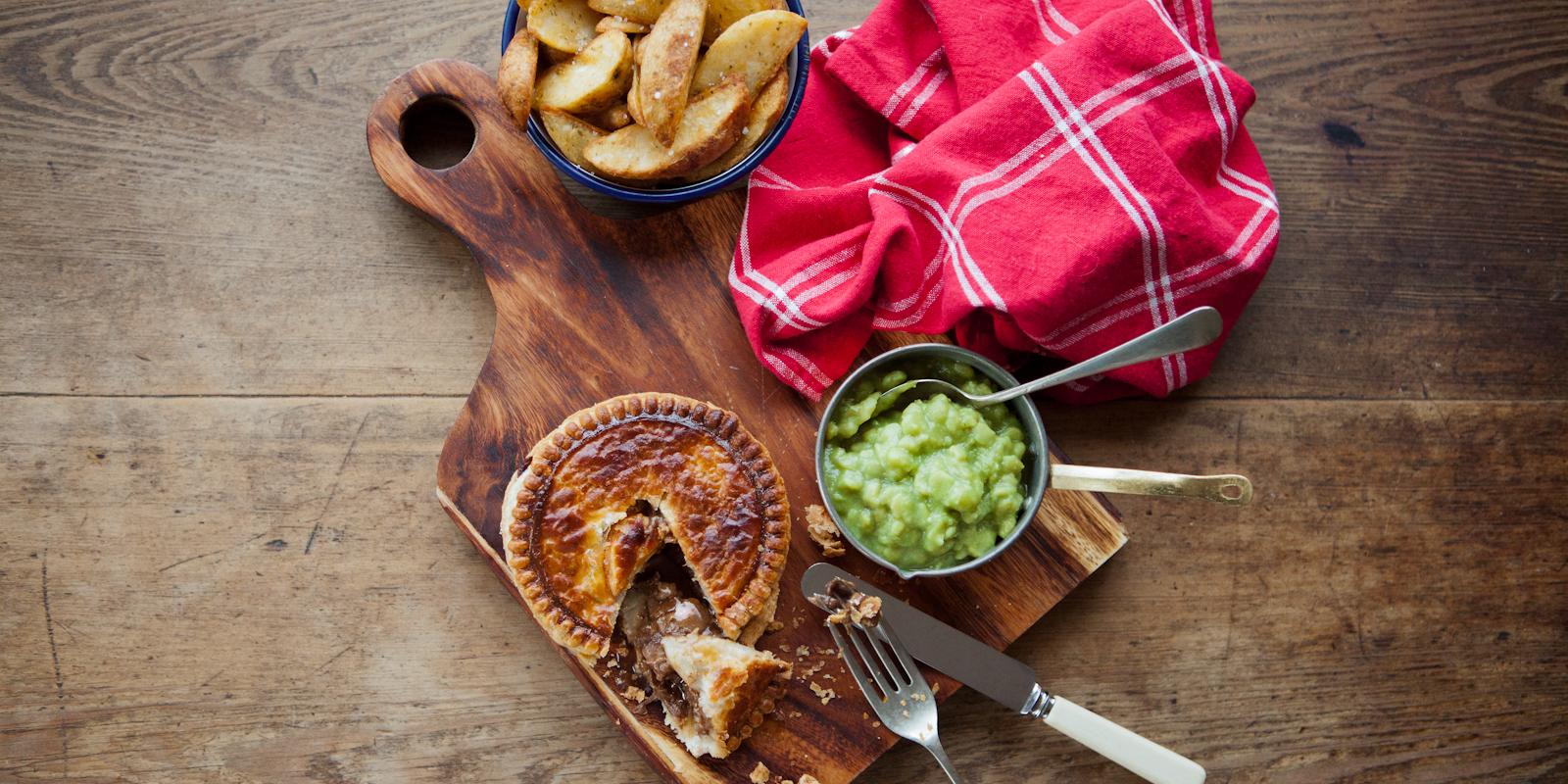 Steak pie, peas and wedges