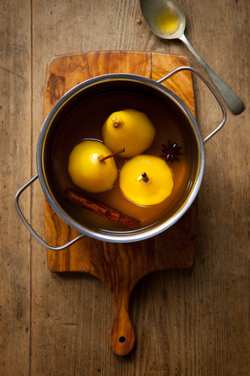 Pears poaching in spiced syrup